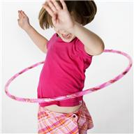 Girl Playing with Hula Hoop --- Image by © Royalty-Free/Corbis
