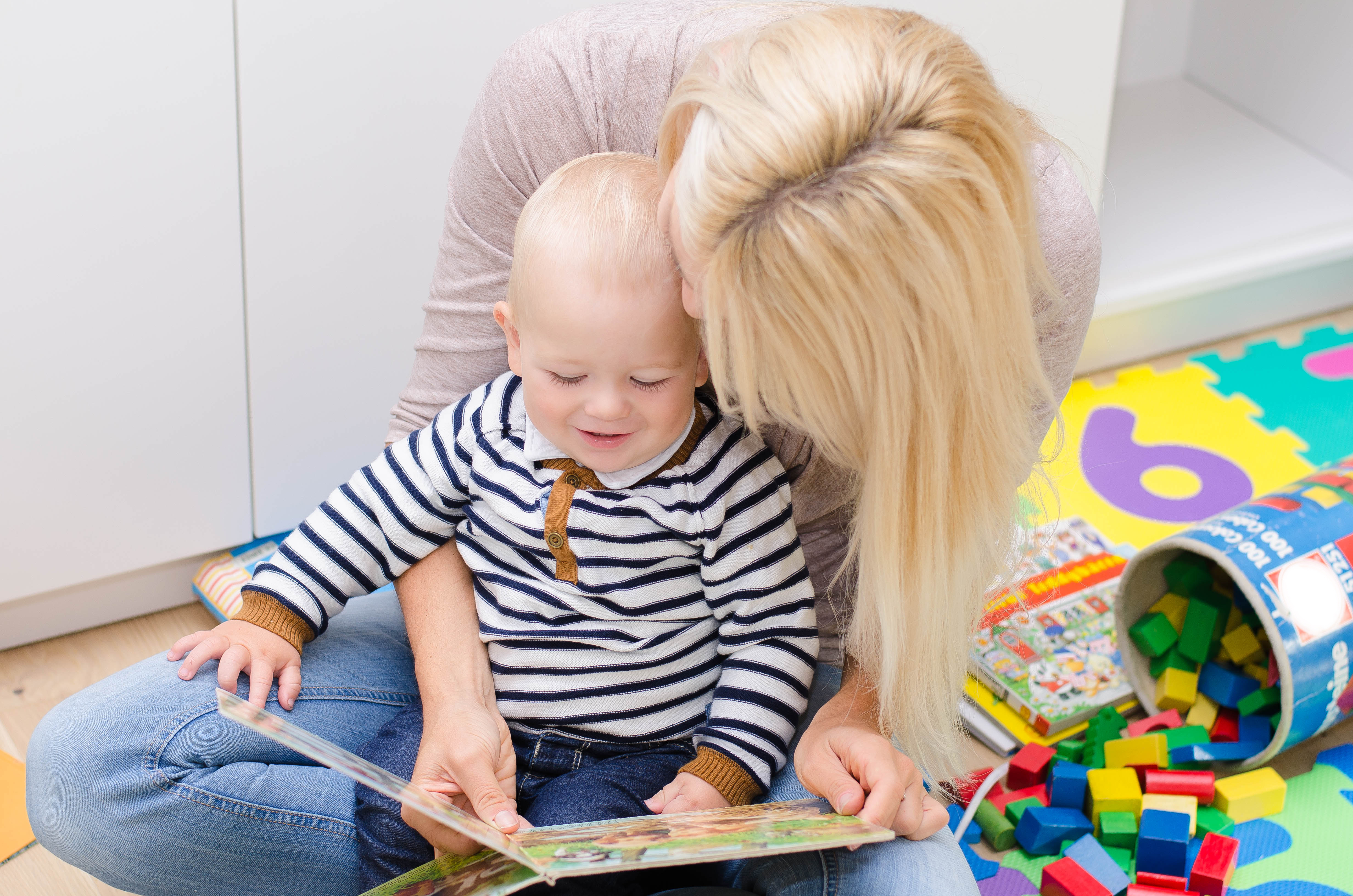 Teaching toddlers to read starts with you reading to them.